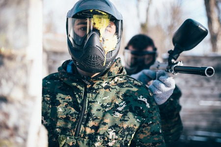 Paintball player in splattered mask, front view Banco de Imagens