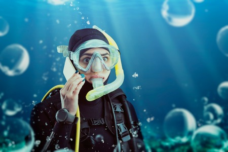 Diver in wetsuit and diving gear, underwater view Stock Photo