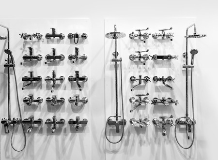 Chrome showers and faucets in plumbing shop