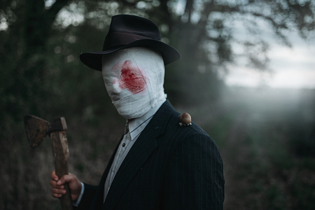 Maniac with axe, face wrapped in bloodied bandages