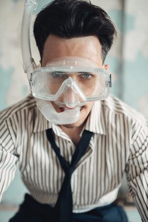 Businessman in swimming mask sitting in bathtub 版權商用圖片
