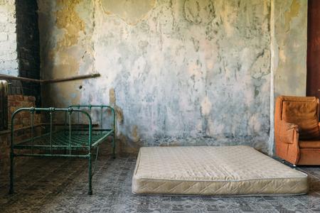 Drug addict room in grunge abandoned house