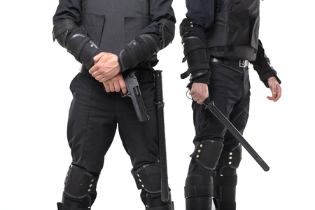 Police with a gun and a baton on white background