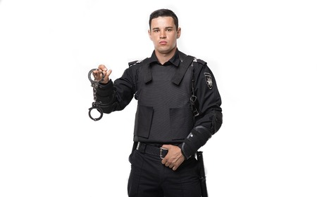 Special force soldier holds handcuffs Stock Photo