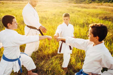 Junior karate team with instructor on training Stock Photo