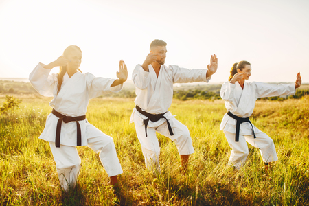 Female karate training skill with instructor