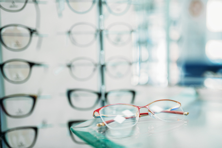 Glasses showcase in optic shop closeup, nobody 免版税图像