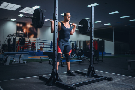 Athlete prepares to make squats with barbell Stock Photo