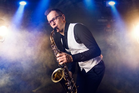 Male saxophonist playing classical music on sax Foto de archivo