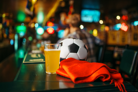 Ball, beer and scarf in sports bar, fans lifestyle