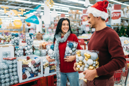 Young couple with boxes full of Christmas balls Stock Photo - 115163969