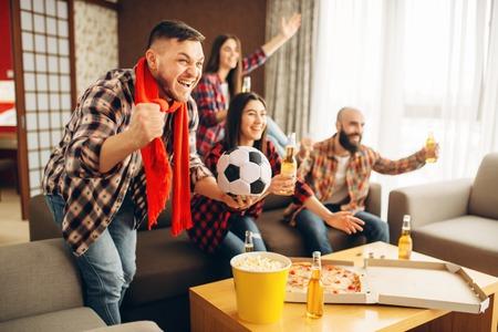 Friends cheer for favorite team, football fans