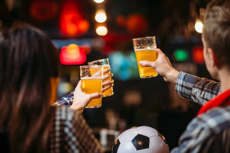 Fans celebrates win of favorite team in sports bar