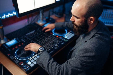 Male sound editor in the recording studio