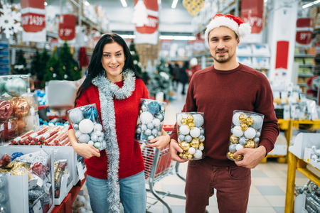 Happy couple holds boxes with Christmas toys Reklamní fotografie