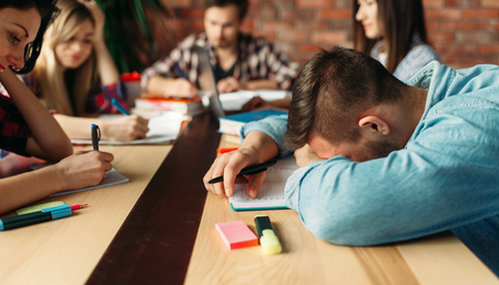 Group of tired students prepares for exams