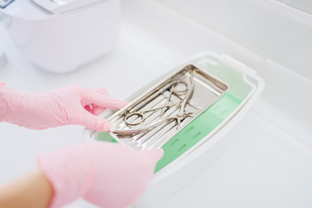 Beautician cleans equipment, tools cleaning