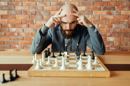 Male chess player playing, thinking process