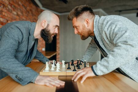 Chess players look into each others eyes