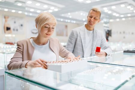 Couple purchase wedding rings in jewelry store