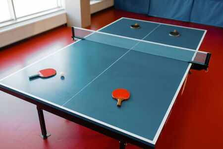 rackets on game table with net, nobody