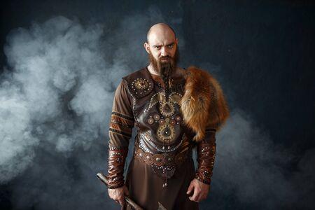 Bearded viking with axe, barbarian image Фото со стока - 129319279