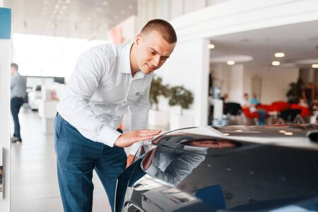 Manager checks the quality of new car paintwork 写真素材