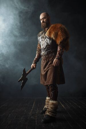 Handsome viking with axe, nordic barbarian image Фото со стока