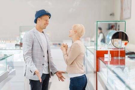 Young love couple buying jewels in jewelry store Фото со стока