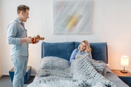Love couple having romantic breakfast in bed