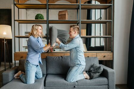 Funny love couple staged fights on the pillows