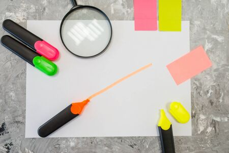 Magnifier and colorful markers in stationery store Banco de Imagens