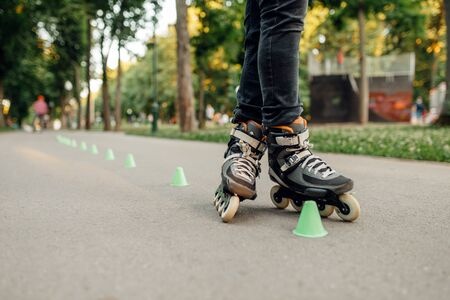 Roller skating, skater rolling around the cones