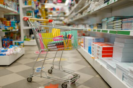 Cart with office supplies in stationery store