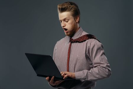 Strong wind blowing on man with laptop