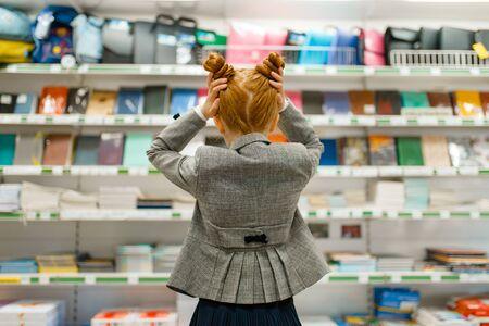 School girl in stationery store, back view Zdjęcie Seryjne