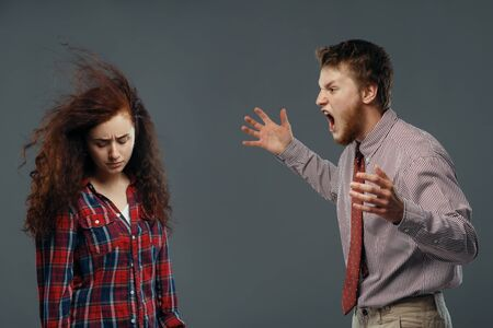 Man shouts on woman, strong wind blowing in face