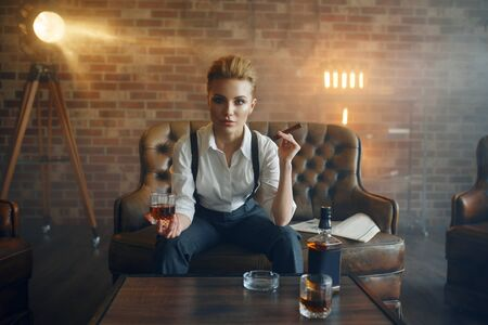 Woman at the table with whiskey, gangster style Reklamní fotografie
