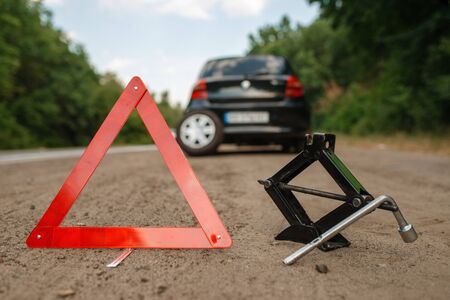 Emergency stop sign, car breakdown, punctured tire