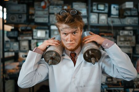 Scientist holds radiation devices in his hands