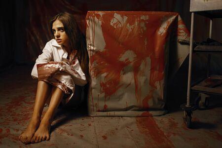 Young female victim in mental hospital basement 스톡 콘텐츠