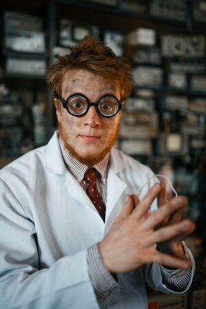 Crazy male scientist working in laboratory