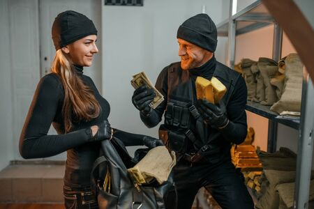 Male and female robbers hacked the vault Stockfoto