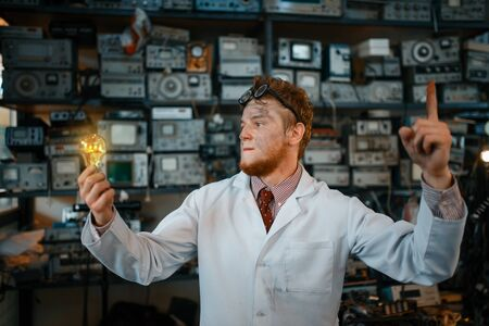 Strange scientist with burning light in his hands