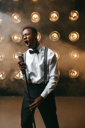 African jazz performer singing on the stage Stock Photo