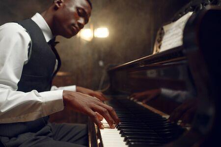 Black grand piano player, jazz performance Stock Photo