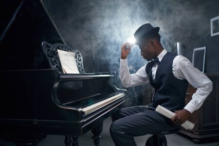 Ebony grand piano player, jazz musician