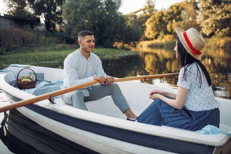Love couple boating on lake, romantic meeting