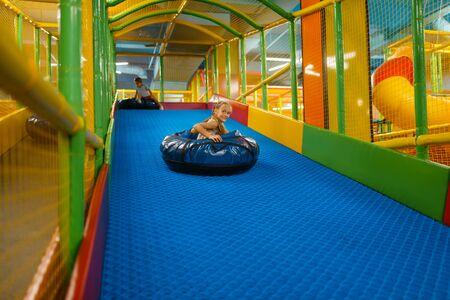Girl rides on tubing, entertainment center