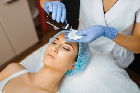 Cosmetician and female patient, skin cleaning